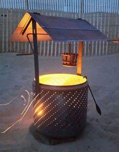 DIY Wishing Well Burn Barrel   Use the tub from a broken washing machine to make a burn barrel that looks like a wishing well.