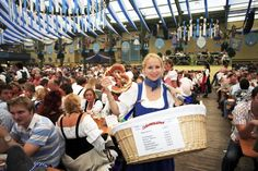 Drink beer by the litre and eat traditional Bavarian pretzels. Join world's greatest folk festival: Oktoberfest Image Courtesy – Munich Tourism #Munich