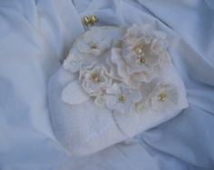 Felted wool bag-Felted wool Purse-Felted handbag -butterflies-Felted Bag-Art Handbag-white  This felted wool bag is made from natural merino wool.Felted wool bag is decorated with wet felted flowers and leaves made from natural merino wool.This It is embelished with pearls and beads. It has a lining and partition inside.Felted bag fastens with a magnetic clasp.  Dimensions: Height 36cm,width 20cm The milled handle bags is 60 cm long…