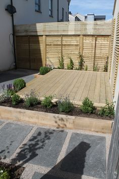 A paved terrace with raised planters using sleepers. Decked steps then lead to a decked softwood terrace. Batten screen fencing was also used to create more privacy and add decoration. Back Garden Design, Backyard Garden Design, Small Backyard Landscaping, Backyard Patio, Landscaping Design, Small Garden Decking Ideas, Small Garden Landscape, Garden Ideas, Raised Patio