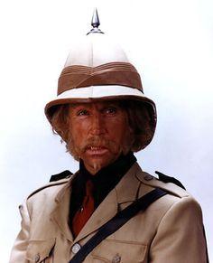 Pith Helmet with Pickelhaube. Tan beigh Safari Jacket with shoulder epaulettes. Black shoulder holster strap.