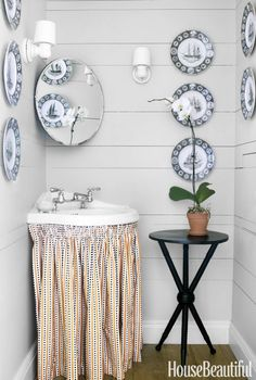 ANGLE IT – Not everything has to line up flush. A corner sink maximizes every inch, while clutter can hide behind the fabric skirt. Click through for more small bathroom ideas.