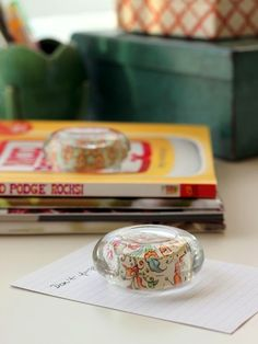 DIY paperweights from glass candle holders. ~ using Mod Podge & resin