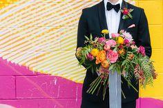 vibrant garden rose and ranunculus bouquet by Juli Vaughn