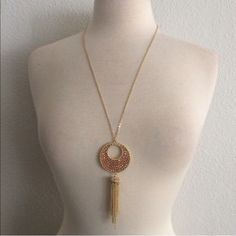"""Topaz crescent tassel necklace Topaz crescent tassel necklace  Adjustable clasp closure. Not too heavy, but definitely not lightweight. Chain is 29"""" total with a 4"""" extender. Hits mid chest. Availability- 3.                                                                   ⭐️This item is brand new with manufacturers tags, boutique tags, or in original packaging. NO TRADES Price is firm unless bundled Ask about bundle discounts Boutique Jewelry Necklaces"""