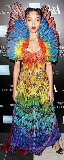 The hot British star stole the show in a rainbow-hued feathered Alexander McQueen dress from the late designer's 2008 archives.