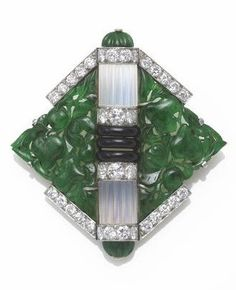An Art Deco jadeite jade, moonstone, black onyx and diamond brooch, Mauboussin, French, circa 1925, signed Mauboussin France, with French assay marks; estimated total diamond weight: 2.00 carats; mounted in platinum-topped eighteen karat gold; dimensions: 1 3/4 x 1 3/4in. #Mauboussin #ArtDeco #brooch