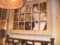 Old window with picture behind it! Cute!