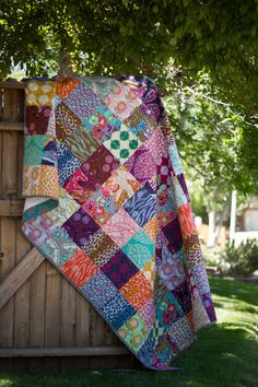 "I love the mismatched colors~ from Marta with Love Field Study fabric line Patchwork Quilt, squares are 7"" finished size."