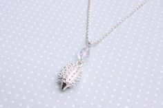 Beautiful hedgehog necklace with iridescent clear crystal drop bead by otterlydesign, $23.99    This is a lovely hedgehog necklace and perfect for spring! The hedgehog charm is adorable and very detailed, it even has little feet! Combined with the iridescent clear crystal drop bead, this necklace is a must for the season.
