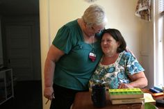 Christine McDonald, right, was initially skeptical of receiving help from nurse Sally Patterson, but after their visits began she was able to bring her blood sugar under control.   http://www.latimes.com/nation/la-na-healthcare-collaboration-20140319-dto,0,2911326.htmlstory#ixzz2wQjq1JLB