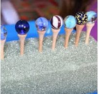 Use tweezers to place marbles on golf tees on a styrofoam block for fine motor development