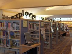 Foam letters arching over tall shelves