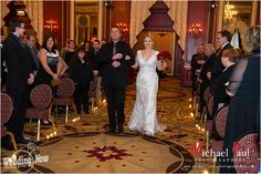 This Chicago wedding at the Palmer House's Red Lacquer Room was absolutely stunning! The bride wore a beautiful fitted lace gown with a red rose bouquet. The groom and his party wore superhero shirts under their shirts and ties to make for a marvelous night. The ballrooms merlot colored walls made for a romantic reception. Such a fun and memorable night! Photos by Michael Paul Photographers