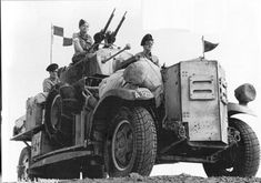 The squadron of armoured cars streaking across the desert after leaving Fort Rutbah, which they captured. Location:Iraq Date taken:1941 Photographer:James Jarche