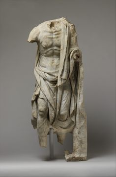 Copy of a Greek statue of the late 3rd century B.C.<br/><br/>The effects of hard work and age are powerfully rendered in this representation. A more complete replica in Rome preserves the head and a basket of fish on the left arm, indicating that the stooped figure must be a fisherman