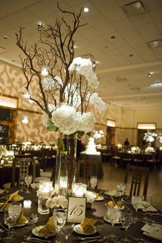 Centerpieces tall vases with branches n candles. Hydrangeas in there as well. Spray paint a few glitter branches. Get the tall vases AND branchs from IKEA at a screaming deal! Branch Centerpieces, Orchid Centerpieces, Tall Wedding Centerpieces, Wedding Reception Decorations, Vases Decor, Table Decorations, Fall Wedding, Our Wedding, Dream Wedding