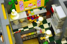 My 19th custom modular Lego building; an apartment building with six lofts and three street-level shops.