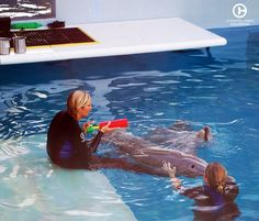 Cammie & Julie enjoying some quality time with Winter and Hope while playing with squirt toys this afternoon. #CMAlife