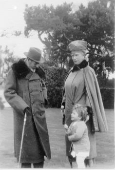 King George V and Queen Mary with their granddaughter Princess Elizabeth of York (later Queen Elizabeth II).