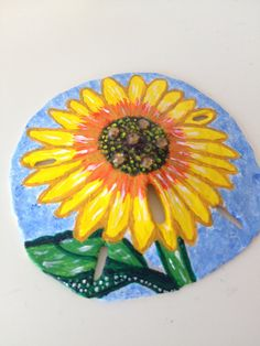 Each sand dollar is hand picked and hand painted using acrylic paint. Some designs are enhanced with Swarovski crystals.