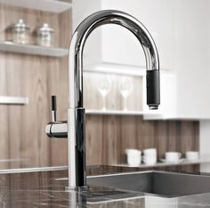 With a twist and lock control, the Perfeque kitchen faucet from Graff blends the perfect amount of function with a stunning form