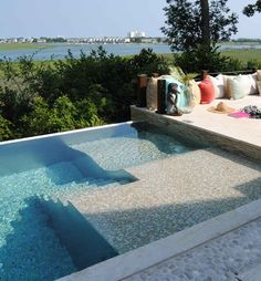 """Pool tile,lounge steps 10' x 33' with electric cover"" ""Love the ""bed"" in this pool!"" ""Nice pool. Love the in pool lounge"""