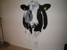 Painted cow on the kitchenwall