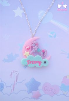 "Cute little unicorn is standing on a pastel shaded fairy moon, which is next to a ""Dreamy"" cloud, so magical! Charm is suspended on a silver tone necklace.  11 €♥"