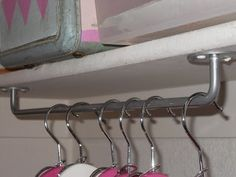 Hang towel bars upside down to use as unexpected hanging storage....so easy!