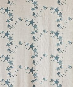 All Star Fabric A neutral linen union fabric printed with gunmetal blue stars, has coordinating wallpaper.