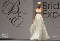 Flowing, strapless wedding gown, Frocks Modern. 2014 Calgary Bridal Expo Fashion Show.