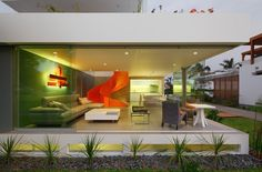 Striking Orange Staircase Visible from Outside of Modern Home - My Modern Met
