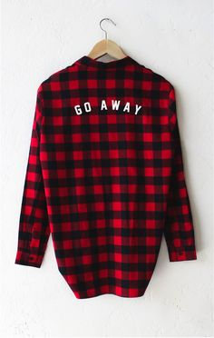 "- Description Details: Relaxed oversized button down plaid flannel shirt in red/black with a patch pocket & print featuring 'Go Away'. Oversized fit. Measurements (Size Guide): S: 40"" bust, 27.5"" leng"