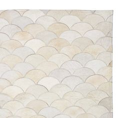 Image from http://chateauandbungalow.com/wp-content/uploads/2014/10/Serena-and-Lily-Scalloped-Hide-Rug.jpg.