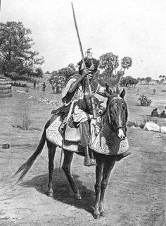 Sudanese man and horse armour probably made of fabric. Note the toe stirrups.