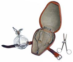 Antique anesthetic set with dropper, mask, tongue holding forceps 1895.