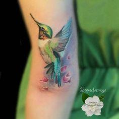 Nice Green Flying Hummingbird Tattoo Design On Arm
