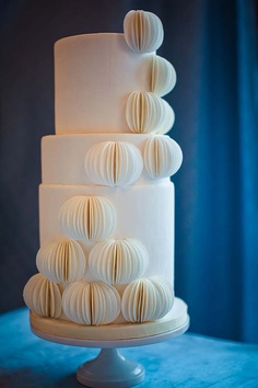 "Inspired by a Lazaro wedding gown with lazer-cut chiffon this cake features sugarpaste ""wafers"" rolled out and individually cut. Cake by Sweet Sensations, Inc. Atlanta, GA. Photo by Esther JuLee Photography. From Grace Ormond Wedding Style."