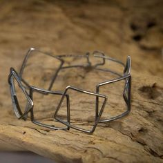 OVERLAPPING SQUARE SILVER BRACELET