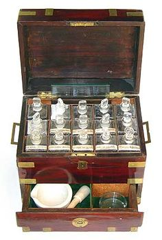 Antique medicine chest with brass banding and full complement of bottles and various accessories, English, c. 1850.