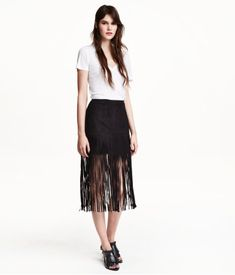 """If you look up """"Fun Hemlines"""" in the dictionary, this fringed skirt from H&M would be the definition.  On-trend for Fall."""