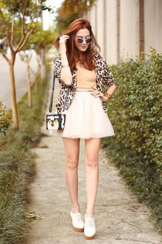 Spring time wearing a cute girly outfit in baby pink with leopard jacket. Focus on the accessories with mini bag and flatforms.