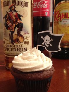 Dirty pirate cupcakes (chocolate cola cupcake w/ rum ganache filling and  Khalua buttercream icing)