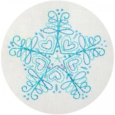 Snowflake Embroidery - I have some dark grey turtlenecks for the twins that are just begging for some snowflakes on them... wonder if I can find the time!