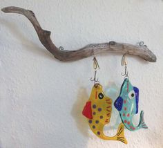 Fused glass fish caught by driftwood