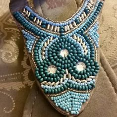 Aqua Beaded Sandals An absolutely beautiful beaded design of varied tones of blue contrasted by a soft grey insole. Size 10 thong styled sandals in superb condition. Shoes Sandals