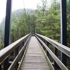 Walk the suspension bridge at Tallulah Gorge, which sways 80 feet above the rocky bottom, providing spectacular views of the river and waterfalls.