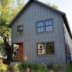 Black Windows, gray trim, wood door