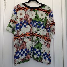 "TOPSHOP blouse size US10, multi-pattern Gently worn, TOPSHOP relaxed woven tee. Ribbed contrast neckline. Fun floral and checkered pattern, various colors. 26 1/2"" length, 100% viscose rayon. Machine wash warm. Topshop Tops Blouses"